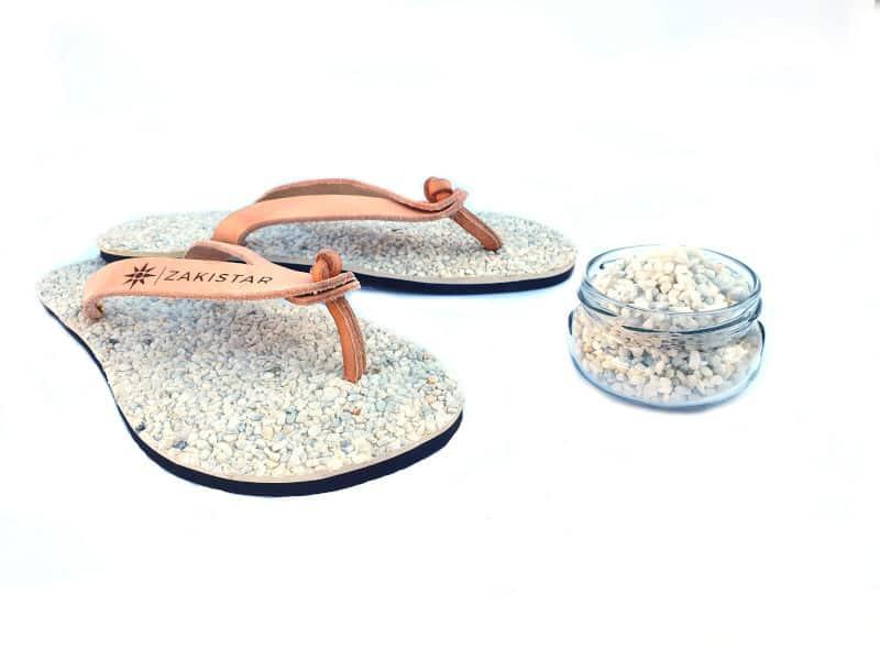 white natural massaging flip flops